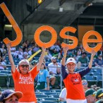 Barbara Moon (on right) and longtime friend Susanna Tom (on left), cheer for Jose Altuve.