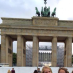 Friends Rebekah Koehn, Katie Ohman, and Arabella Benavides in front of the Brandenburg Gate in Berlin, Germany.