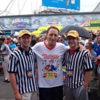 Zach Pearson (left) and his friend Andrew Hoffman (right) pose for a photo with champion competitive eater, Joey Chestnut (center). Both Zach and Andrew were judges at the Nathan's hot dog eating contest this summer.