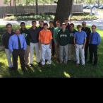 (From left) Brandon Bain, theology teacher Mr. Tommy Romano, Martin Montalvo, Nick Tanner, Felix Read, Patrick Sullivan, Toan Cao, Austin Miller, Jeremy Brown, Michael Blaschke, Thomas Neiers, Brandon Solcher, Fr. Flavio Bravo, Jesuit Father, Head of Past