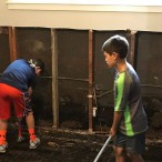 Boys helping clean up