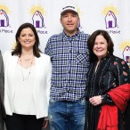Charlie and Susan Neuhaus, Bode Miller, executive director Mary Beth Staine, and Kate and Logan Walters