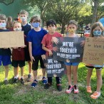 Kids participating in march