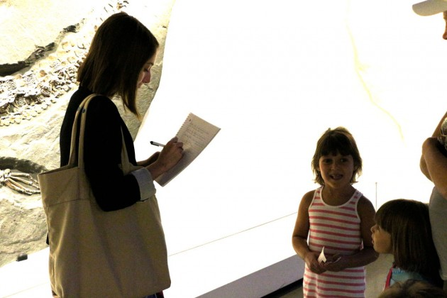 Intern Alex Daily chats with Emma about why she likes the crystal exhibit.
