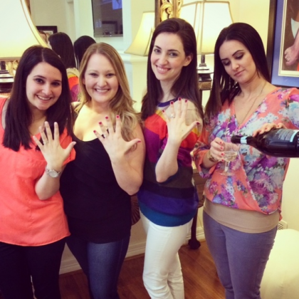(From left) Sisters Melanie, Melissa and Amy displaying their rings and Lauren, on right, pouring the champagne to toast her younger sister's engagement. (Photo: Mark Finkelstein)