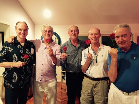 (From left) Pat Reddy, Rich Maloney, Ken Kades, Howard Dyer-Smith and Mike Brier, holding roses for their wives.