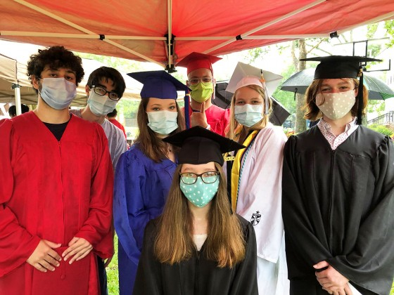Grads with masks on
