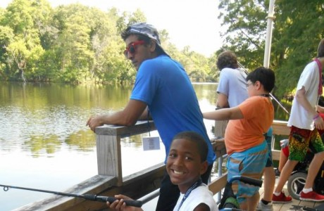 Camper B.J. Bond fishing with his counselor. (Photo provided by MDA Houston Goodwill Ambassadors)