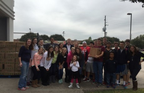 Group photo outside of West Houston Assistance Ministries.