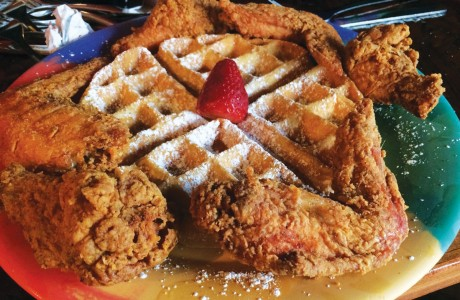 Belgian waffle served with succulent fried-chicken wings