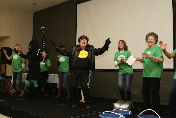 Pat McLaughlan performing; wife Diane McLaughlan, laughing in back.