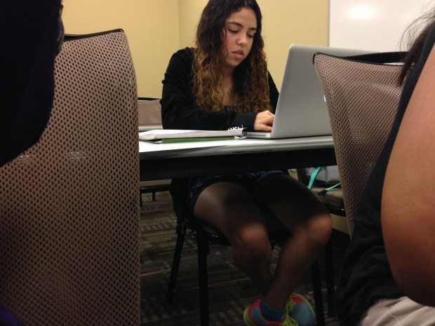 Jasmine Khademakbari, a junior, writing a review for a class project.